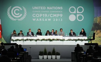 Climate negotiations overshadowed by typhoon