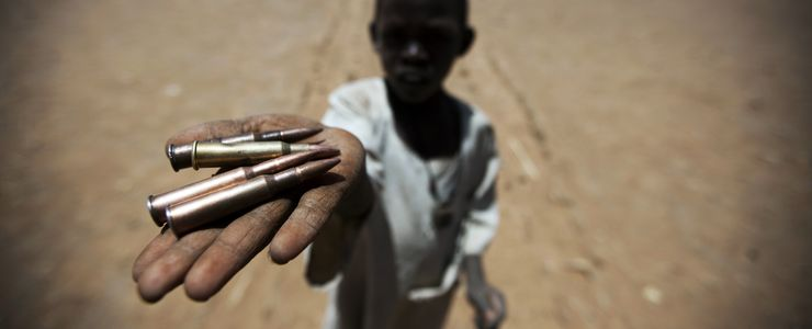 photo A child holds up bullets collected